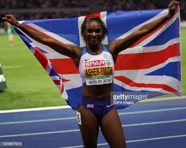 Dina AsherSmith representing Great Britain celebrates with the British flag after the Women's 200m on Day 5 of the European Athletics Championships...