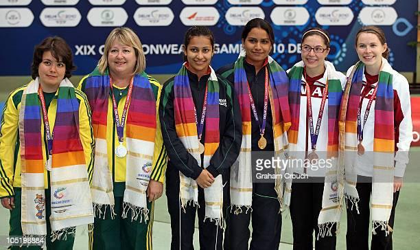 Dina Aspandiyarova and Pamela McKenzie of Australia Heena Sidhu and Annu Raj Singh of India and Lynda Hare and Dorothy Ludwig if Canada after...