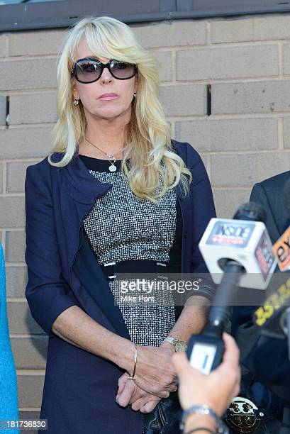 Dina Lohan appears in court after her arrest on September 12 2013 for Driving While Intoxicated and Speeding at Nassau County First District Court on...