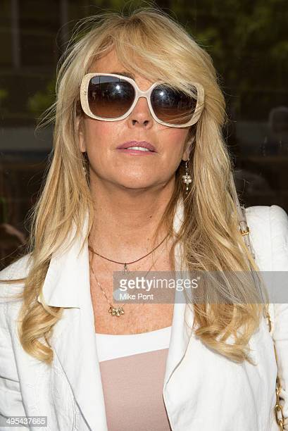 Dina Lohan appears in court at Nassau County First District Court on June 3 2014 in Hempstead New York Lohan pleaded guilty to aggravated driving...