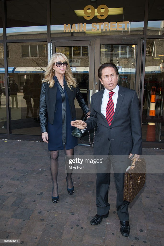 Dina Lohan (L) appears in court with Attorney Mark Heller after her arrest on September 12, 2013 for driving while intoxicated and speeding at Nassau County First District Court on November 21, 2013 in Hempstead, New York.