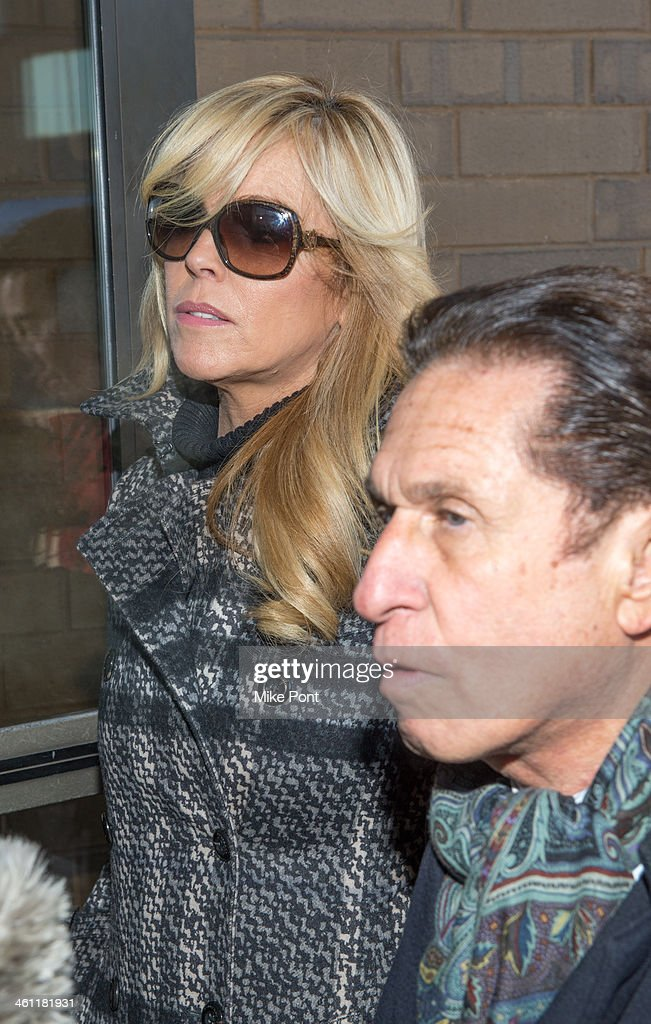 Dina Lohan (L) appears in court with Attorney Mark Heller after her arrest on September 12, 2013 for Driving While Intoxicated and speeding at Nassau County First District Court on January 7, 2014 in Hempstead, New York.