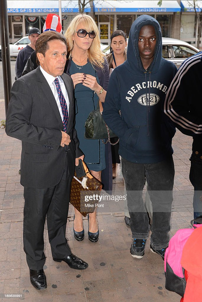 Dina Lohan (2nd from L) appears with Attorney Mark Heller (L) at Nassau County First District Court after her arrest on September 12, 2013 on suspicion of driving while intoxicated after she was pulled over for speeding on Long Island, on October 23, 2013 in Hempstead, New York.