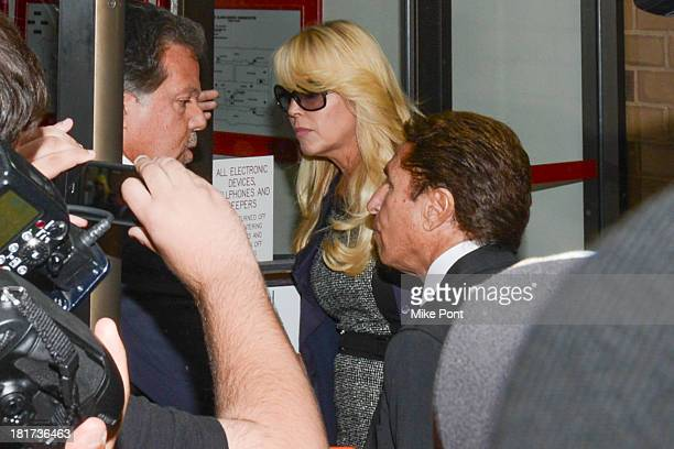 Dina Lohan arrives at court after her arrest on September 12 2013 for Driving While Intoxicated and speeding at Nassau County First District Court on...