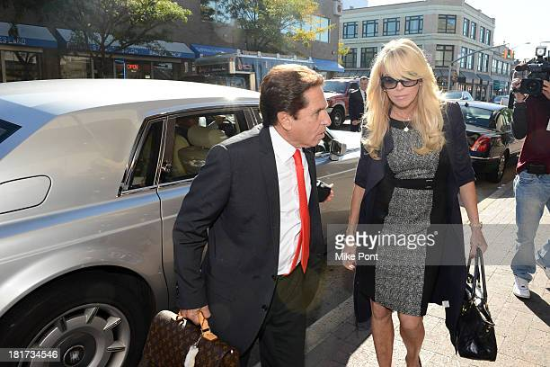 Dina Lohan arrives at court with attorney Mark Heller after her arrest on September 12 2013 for Driving While Intoxicated and Speeding at Nassau...