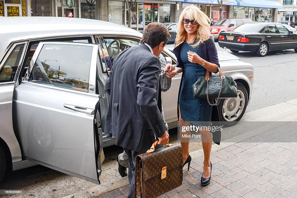 Dina Lohan (R) arrives with Attorney Mark Heller at Nassau County First District Court after her arrest on September 12, 2013 on suspicion of driving while intoxicated after she was pulled over for speeding on Long Island, on October 23, 2013 in Hempstead, New York.