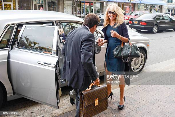 Dina Lohan arrives with Attorney Mark Heller at Nassau County First District Court after her arrest on September 12 2013 on suspicion of driving...