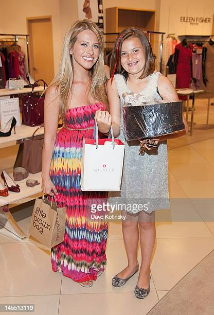 Dina Manzo and auction winner attends the Project Ladybug/LK Bennett event at the Bloomingdale's The Shops at Riverside on May 31 2012 in Hackensack...