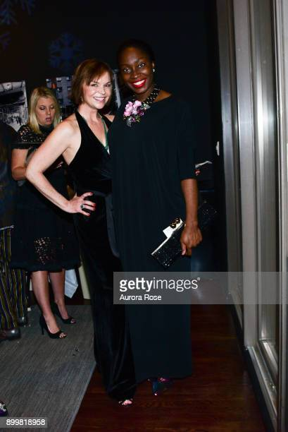 Dina McCoy and Tinu attend Tracy Stern hosts holiday party at private townhouse in Hell's Kitchen at Private Residence on December 14 2017 in New...