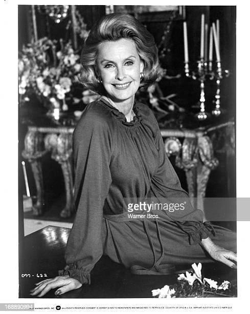 Dina Merrill sits on a table in publicity portrait for the film 'Just Tell Me What You Want', 1980.