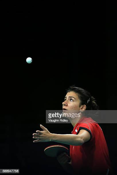 Dina Meshref of Egypt serves to Yu Mengyu of Singapore during the Women's Team Round 1 on Day 7 of the Rio 2016 Olympic Games at Riocentro Pavilion 3...