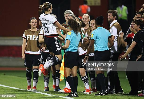 Dina Orschmann of Germany celebrates her goal with her team on the bench during the FIFA U-20 Women's World Cup Papua New Guinea 2016 Group D match...