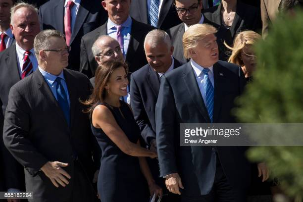 Dina Powell Deputy National Security Advisor for Strategy looks on as President Donald Trump arrives for a group photo with members of the White...