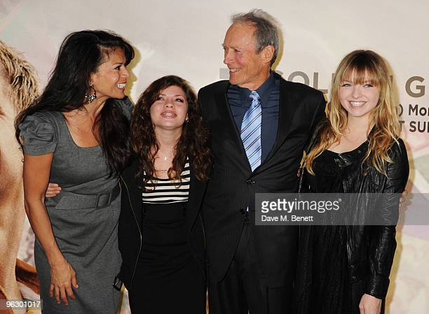 Dina Ruiz and Clint Eastwood with daughters Morgan and Francesca arrive at the UK film premiere of 'Invictus' at Odeon West End on January 31 2010 in...