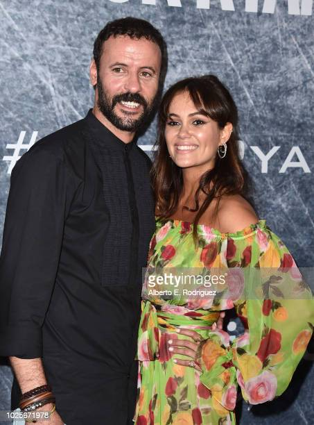 Dina Shihabi and Ali Suliman attend the premiere of Amazon Prime's of 'Tom Clancy's Jack Ryan' at the Battleship Iowa on August 31 2018 in San Pedro...
