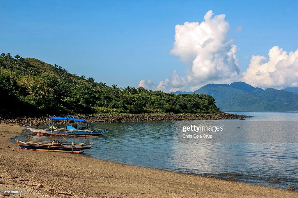 Dinagalan beach with boats : Stock Photo