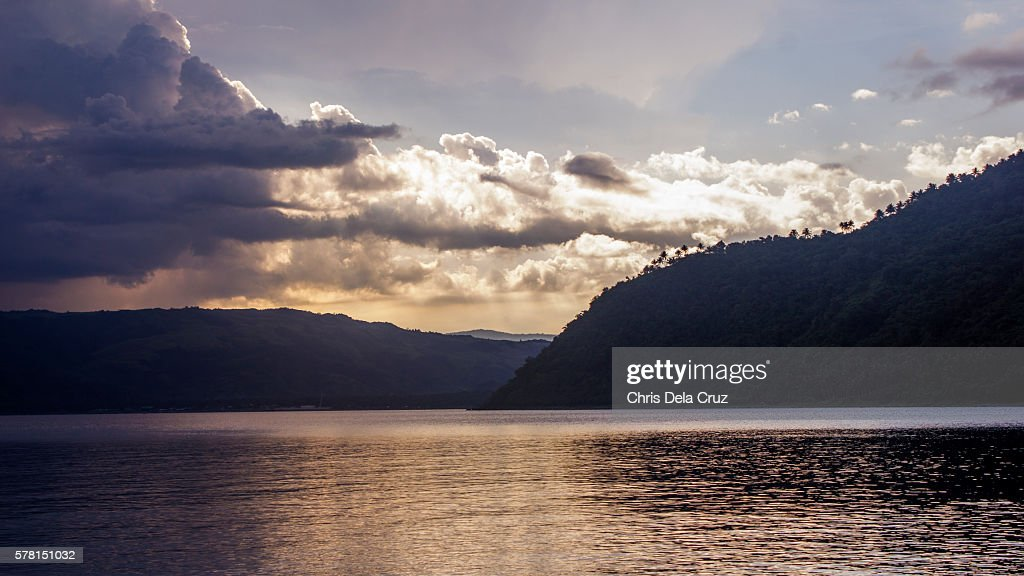 Dinaglan beach with lavender and cloudy sky : Stock Photo