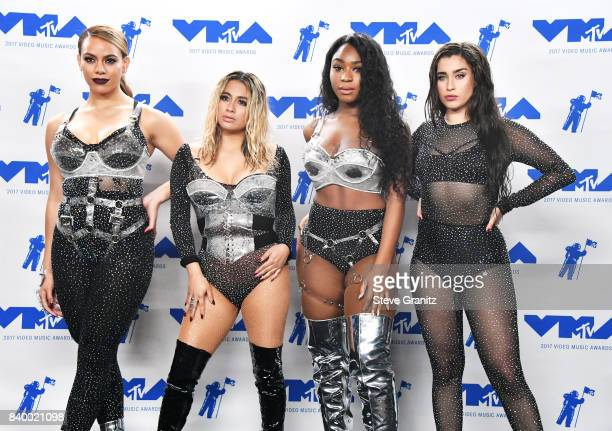 Dinah Jane Ally Brooke Normani Kordei and Lauren Jauregui of Fifth Harmony winners of Best Pop for 'Down' pose in the press room during the 2017 MTV...