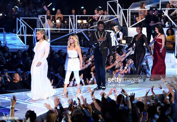 Dinah Jane and Ally Brooke of Fifth Harmony Gucci Mane Normani Kordei and Lauren Jauregui of Fifth Harmony walk onstage to accept the Best Pop award...