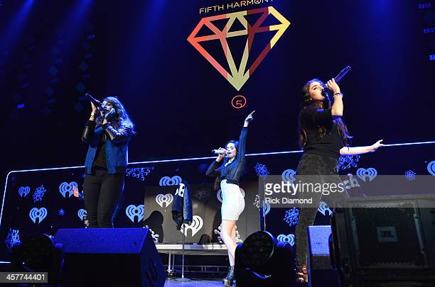 Dinah Jane Hansen Camila Cabello and Lauren Jauregui of Fifth Harmony perform onstage during 933 FLZ's Jingle Ball 2013 at the Tampa Bay Times Forum...