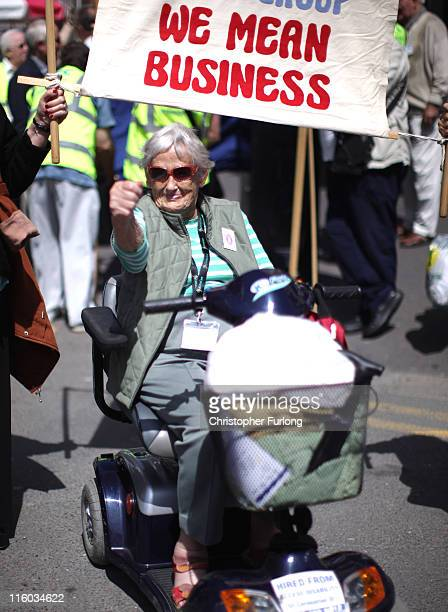 Dinah Laing age 89 joins other pensioners as they take part in a march through Blackpool to attend the annual Pensioners Parliament at The Winter...