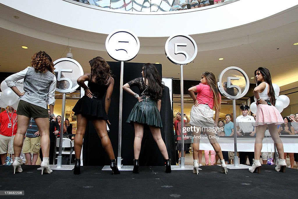 Dinah-Jane Hansen, Normani Hamilton, Lauren Jauregui, Ally Brooke and Camila Cabello of Fifth Harmony perform at the Square One Mall on July 15, 2013 in Saugus, Massachusetts.