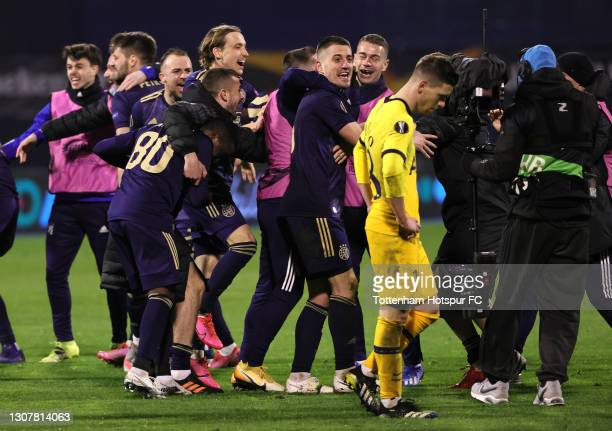 Dinamo Zagreb players and staff celebrate victory following the UEFA Europa League Round of 16 Second Leg match between Dinamo Zagreb and Tottenham...