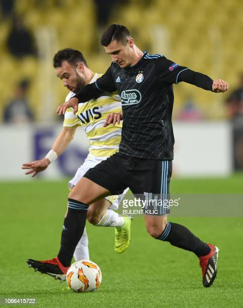 Dinamo Zagreb'Amer Gojak vies for the ball with Fenerbahce's Mathieu Valbuena during the UEFA Europa League Group D soccer match between Fenerbahce...