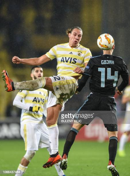 Dinamo Zagreb's Amer Gojak and Fenerbahce's Michael Frey jump for the ball during the UEFA Europa League Group D soccer match between Fenerbahce and...