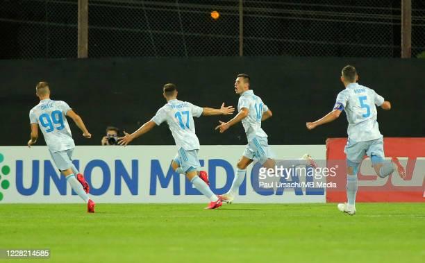 Dinamo Zagrebs Amer Gojak celebrating a goal with his team-mates Miroslav Tolic, Luka Ivanusec and Arijan Ademi during UEFA Champions League Second...