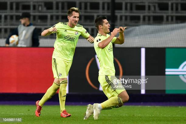 Dinamo Zagreb's Bosnian midfielder Amer Gojak celebrates after scoring during the Europa League Group D football match between Anderlecht and Dinamo...