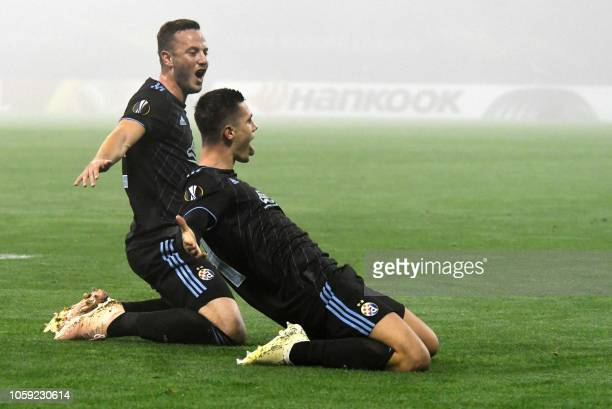 Dinamo Zagreb's Bosnian midfielder Amer Gojak celebrates after scoring a goal during the UEFA Europa League Group D secondleg football match between...
