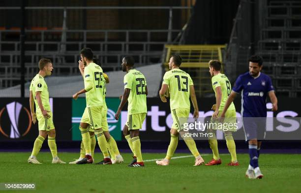 Dinamo Zagreb's Bosnian midfielder Amer Gojak celebrates with his teammates after scoring during the Europa League Group D football match between...