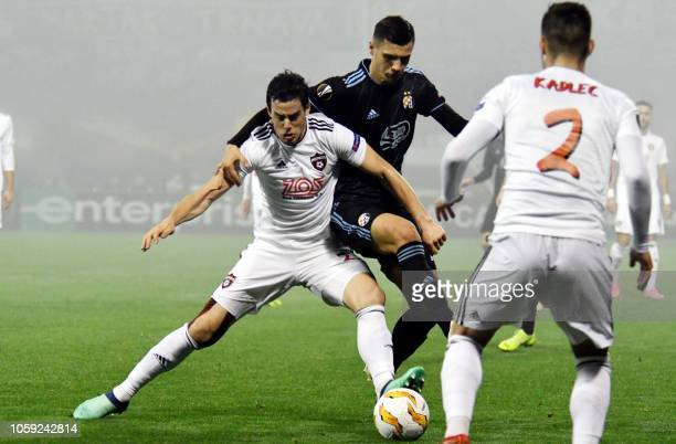Dinamo Zagreb's Bosnian midfielder Amer Gojak vies for the ball with Spartak Trnava's Czech midfielder Jakub Rada during the UEFA Europa League Group...