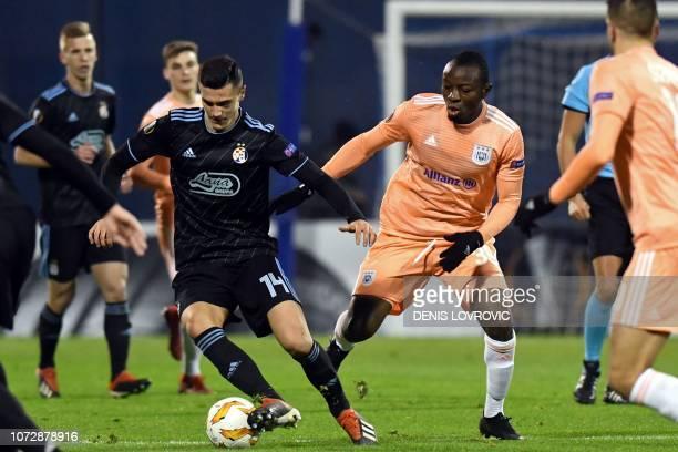 Dinamo Zagreb's Bosnian midfielder Amer Gojak vies with Anderlecht's Congolese midfielder Edo Kayembe during the UEFA Europa League Group D football...