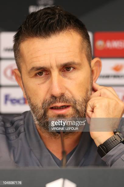 Dinamo Zagreb's Croatian coach Nenad Bjelica looks on during a press conference in Anderlecht on October 3 on the eve of their UEFA Europa league...
