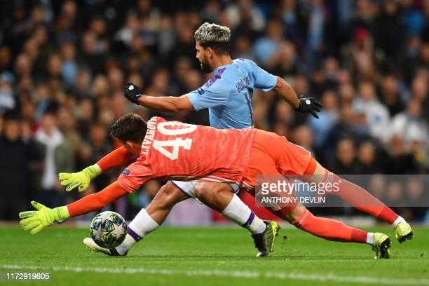 Dinamo Zagreb's Croatian goalkeeper Dominik Livakovic dives to block a shot from Manchester City's Argentinian striker Sergio Aguero during the UEFA...