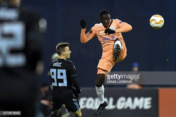 Dinamo Zagreb's Croatian midfielder Mislav Orsic looks at Anderlecht's French defender Dennis Appiah controlling the ball during the UEFA Europa...