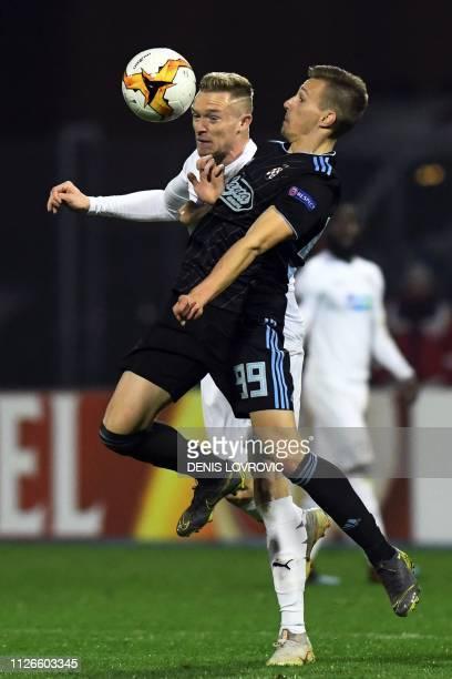 Dinamo Zagreb's Croatian midfielder Mislav Orsic vies with Viktoria Plzen's defender Roman Prochazka during the UEFA Europa League round of 32...