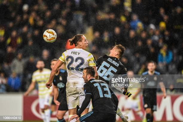 Dinamo Zagreb's Emir Dilaver and Amir Rrahmani vie with Fenerbahce's Michael Frey during the UEFA Europa League Group D soccer match between...