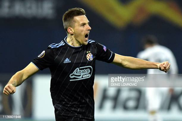 Dinamo Zagreb's forward Mislav Orsic celebrates after scoring a goal during the UEFA Europa League round of 32 second-leg football match between...