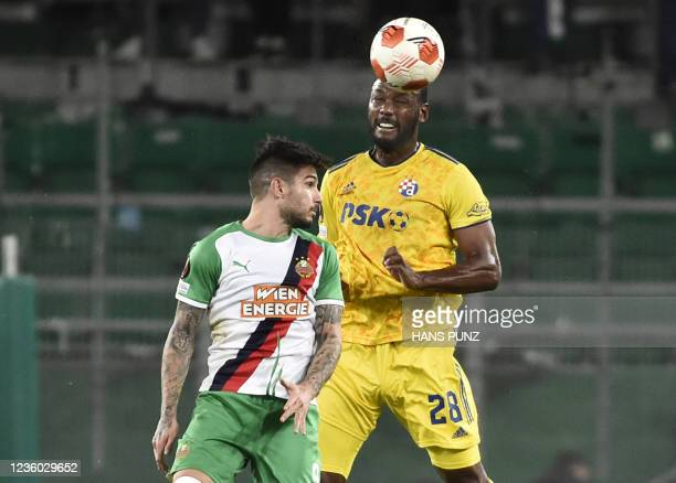 Dinamo Zagreb's French defender Kevin Theophile-Catherine and Rapid Wien's Greek midfielder Taxiarchis Fountas vie for the ball during the UEFA...