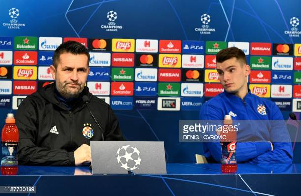 Dinamo Zagreb's headcoach Nenad Bjelica and goalkepeer Dominik Livakovic attend at a press conference at the Maksimir stadium in Zagreb on December...