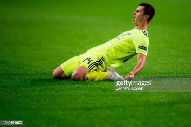Dinamo Zagreb's midfielder Amer Gojak celebrates after scoring a goal during their Europa League Group D football match Belgium's RSC Anderlecht...