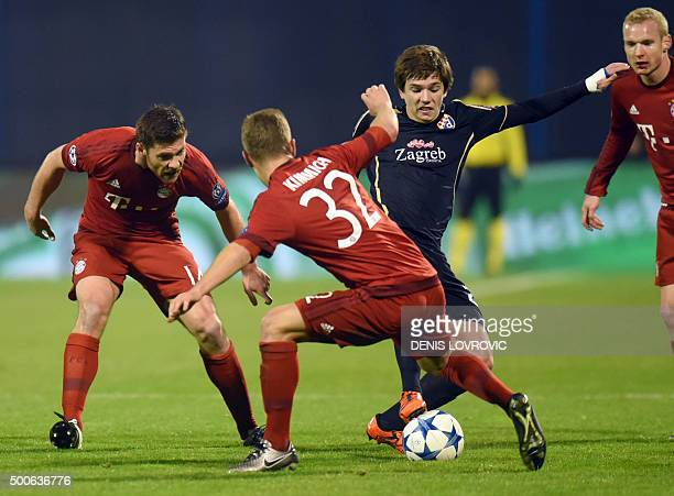 Dinamo Zagreb's midfielder Ante Coric vies with Bayern Munich's Spanish midfielder Xabi Alonso and Bayern Munich's midfielder Joshua Kimmich during...