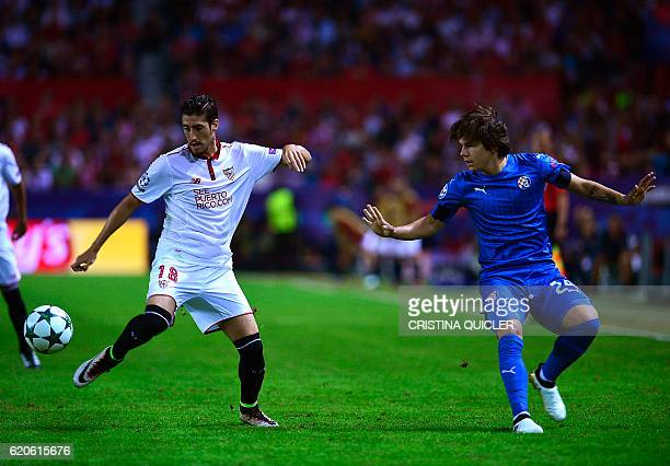 Dinamo Zagreb's midfielder Ante Coric vies with Sevilla's defender Sergio Escudero during the UEFA Champions League Group H football match Sevilla FC...