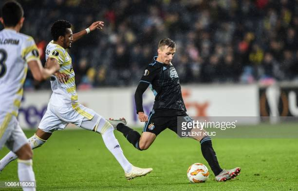 Dinamo Zagreb's Mislav Orsic vies for the ball with Fenerbahce's Jailson during the UEFA Europa League Group D soccer match between Fenerbahce and...