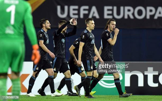 Dinamo Zagreb's players celebrate after scoring a goal during the UEFA Europa League round of 32 second-leg football match between Dinamo Zagreb and...