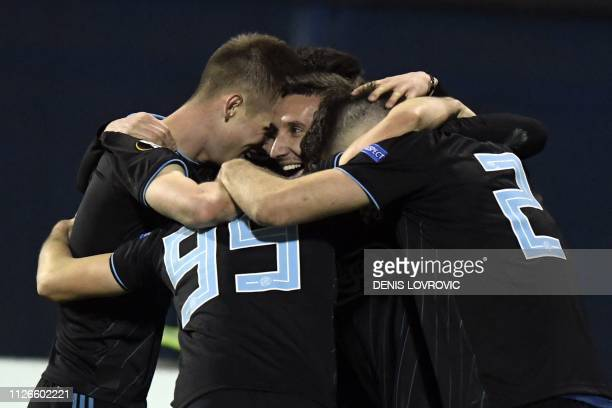 Dinamo Zagreb's players celebrate after scoring their third goal during the UEFA Europa League round of 32 secondleg football match between Dinamo...