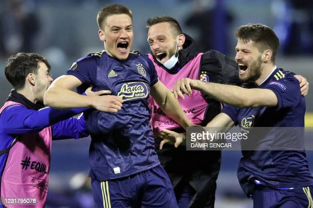 Dinamo Zagreb's players celebrate their 3-0 victory at the end of the UEFA Europa League round of 16 second leg football match between Dinamo Zagreb...